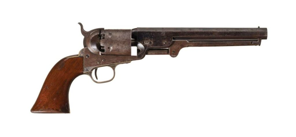 A percussion Model 1851 Navy Revolver made in 1857 on a white background..