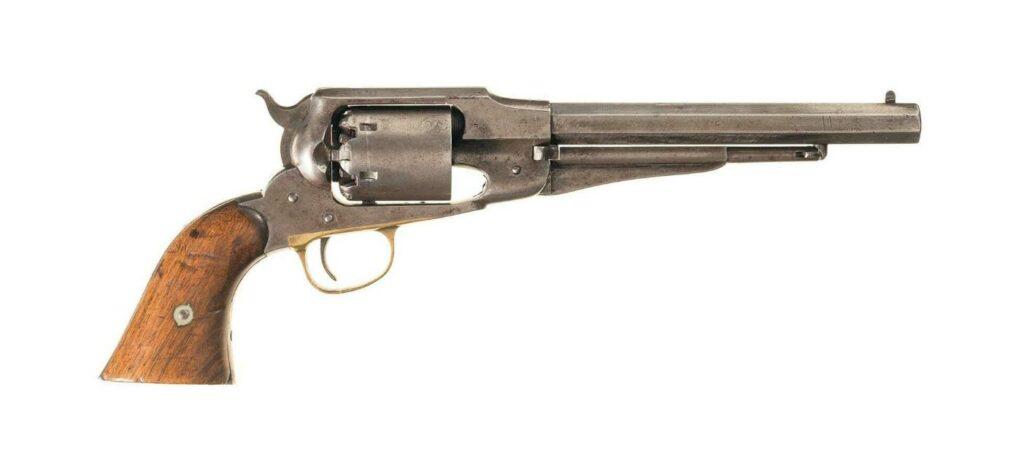 A exposed-hammer W.W. Greener shotgun on a white background.