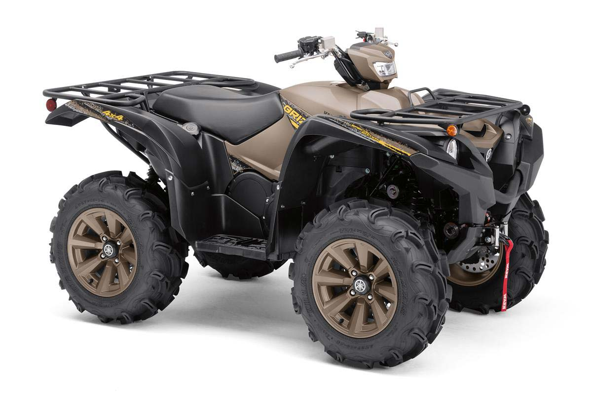 A brown and black Yamaha Grizzly ATV on a white background.