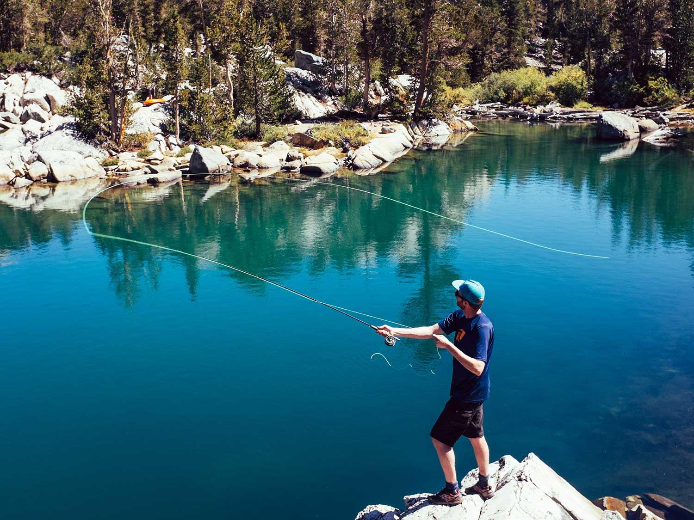Man wearing sunglasses while fishing.