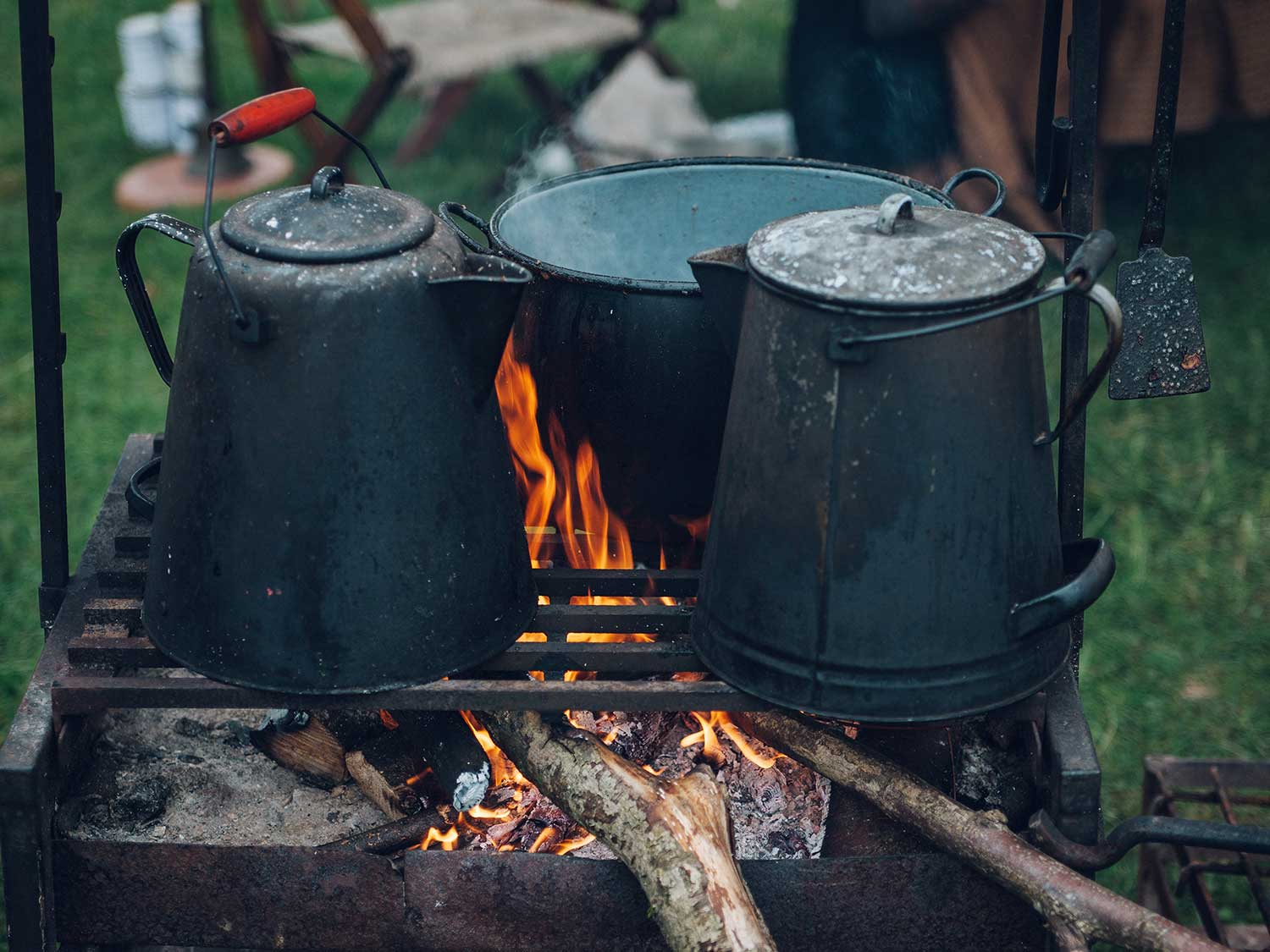 Camp coffee pots over campfire.