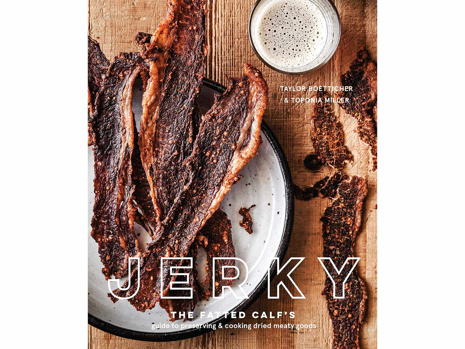 A book cover with beef jerky on a wooden table.