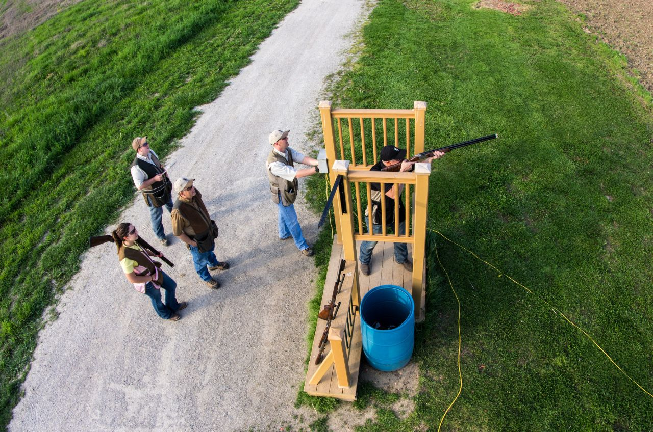 a group of shooters at a sporting clays course.