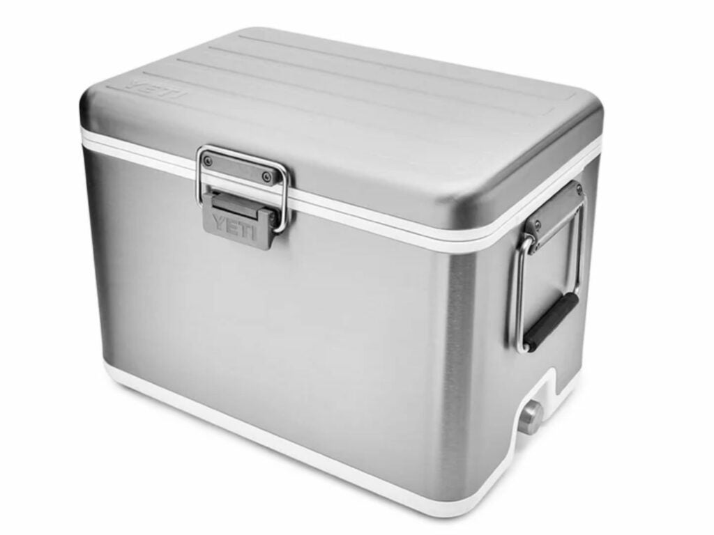 A silver yeti stainless steel cooler.