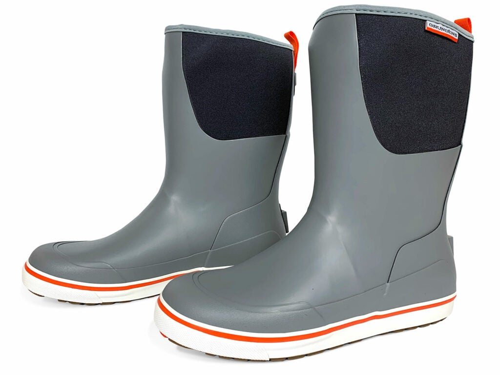A pair of grey and black waterproof deck boots.
