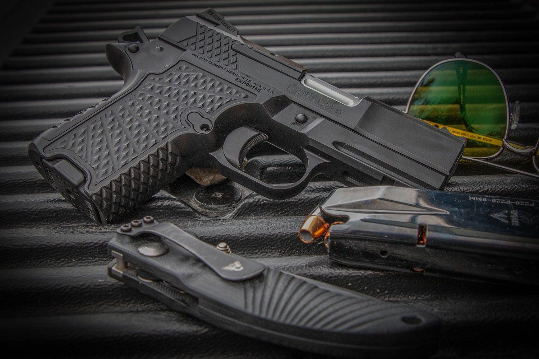 A Weston Combat handgun and accessories.