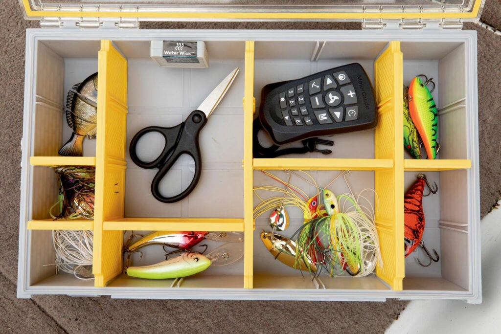 A drawer of tools and lures fitted with yellow custom dividers