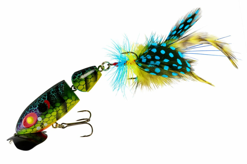 A segmented blue, yellow and green fishing lure.