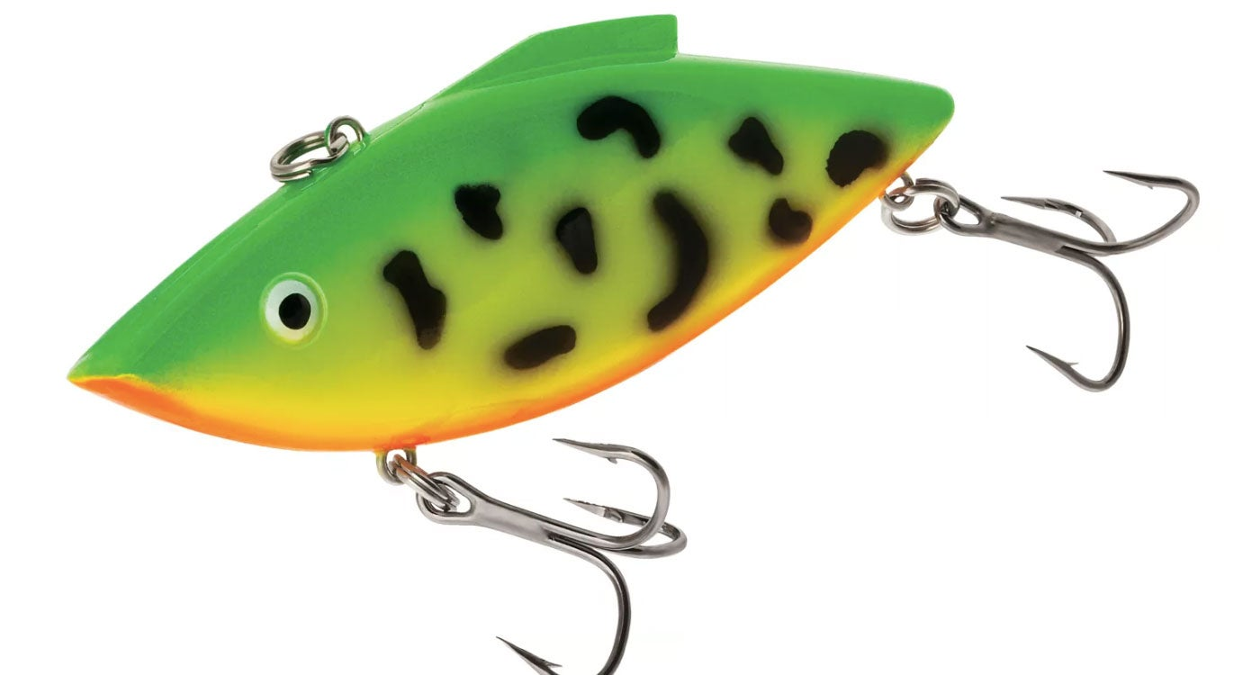 A green lure with black spots on a white background.