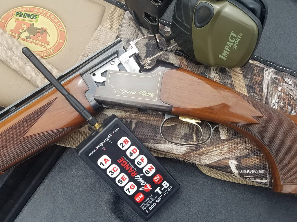 A Browning shotgun and other hunting gear.