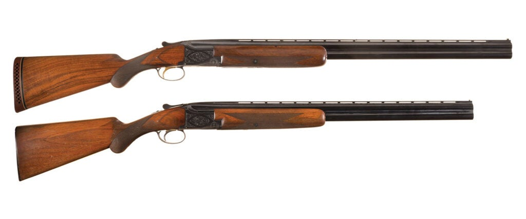 Two browning shotguns on a white background.