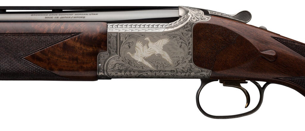 A close up engraving on the stock of a Browning shotgun