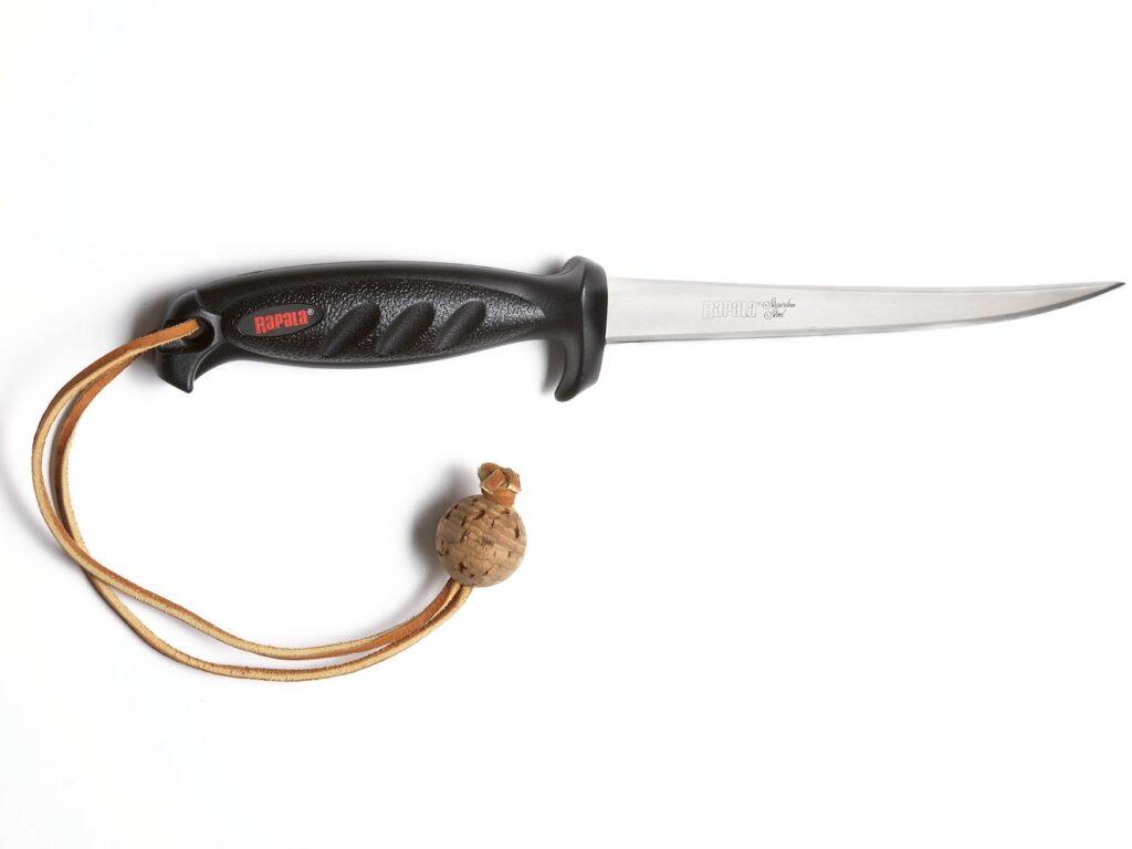 A filet knife on a white background.