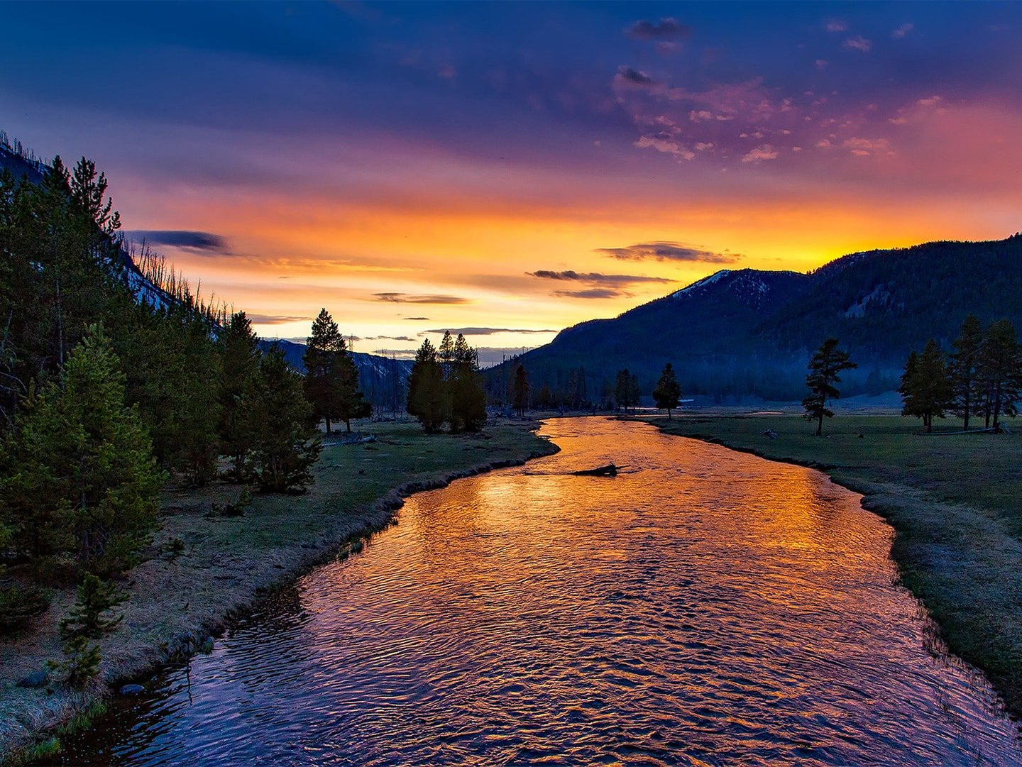 A sunset overlooking the Yellowstone River in Yellowstone National Park.