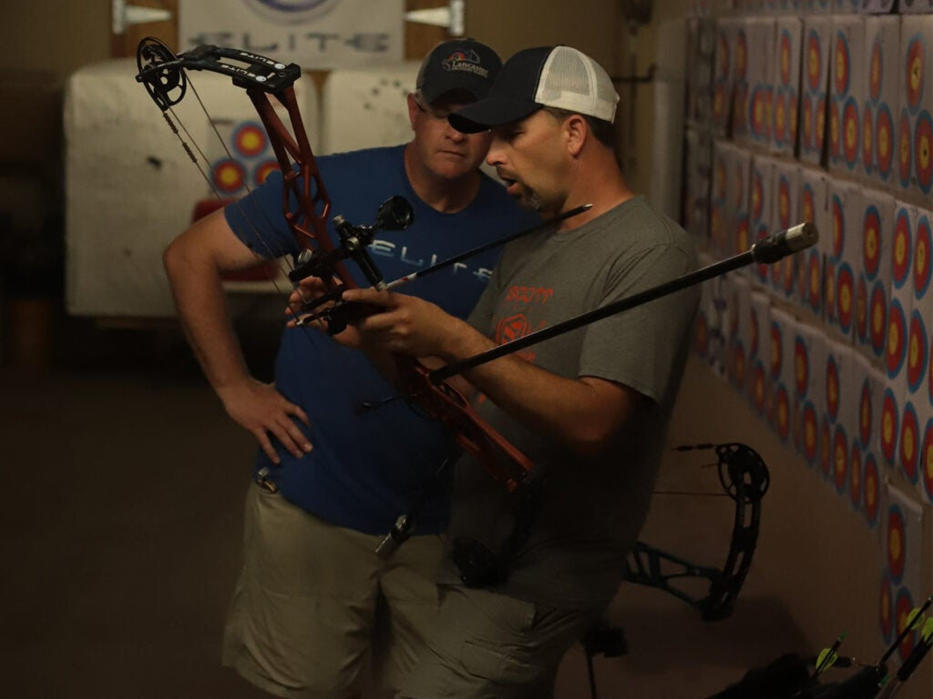 Two men in a bow shot at Elite Archery.