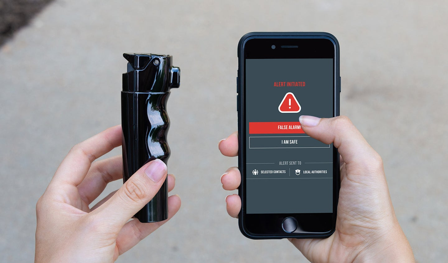 Two hands holding a device and a cell phone.