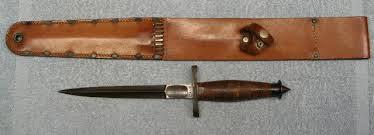 A v42 combat knife and a leather sheathe.
