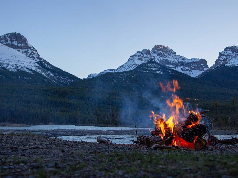 fire pit by a lake