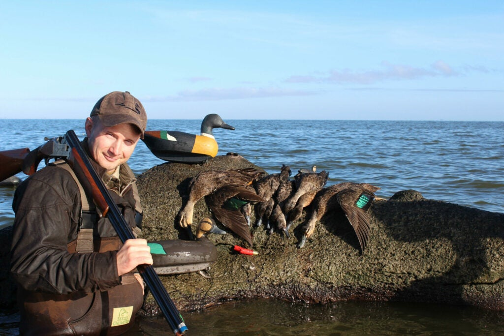 Duck hunter with ducks.