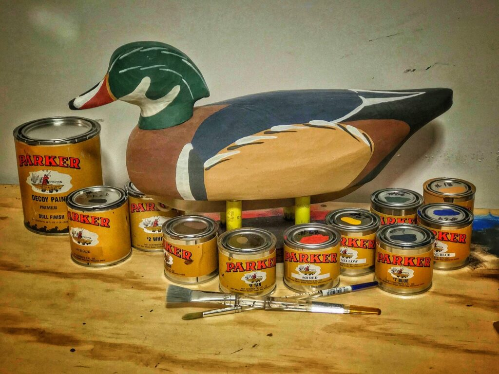 Painted duck decoy with paint.