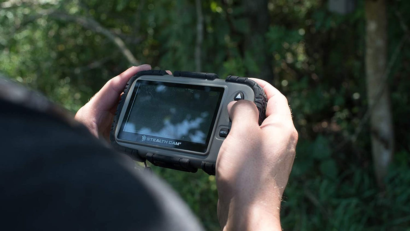 Person holding an SD viewer