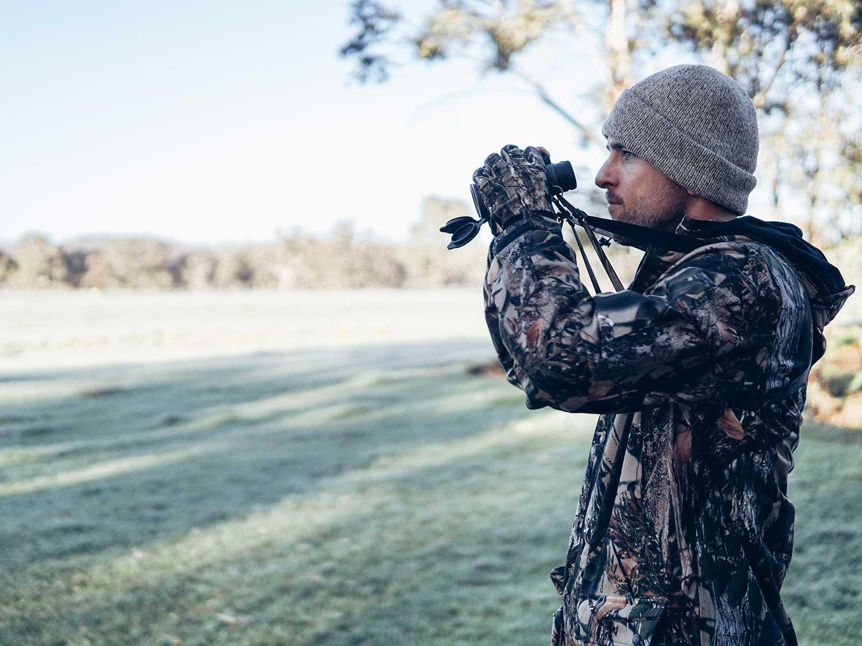 hunter using binoculars