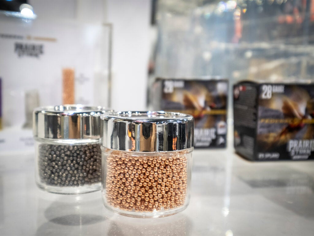 Jars of pellets on tables at the SHOT Show convention.