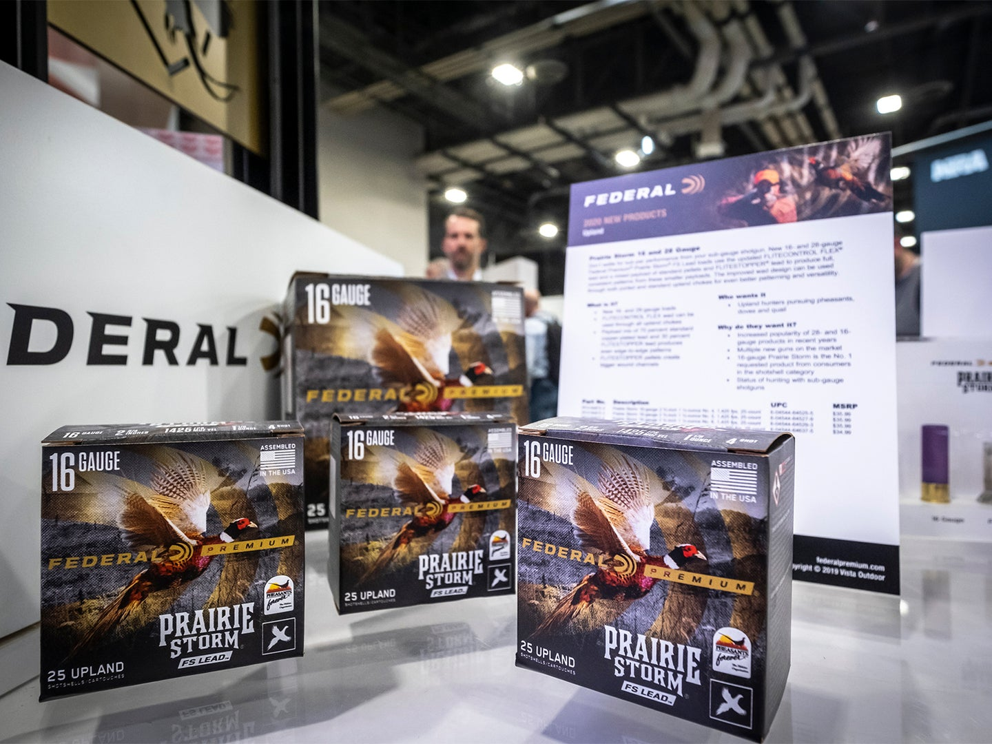 Boxes of Federal Premium ammo stacked on tables at the SHOT Show convention.