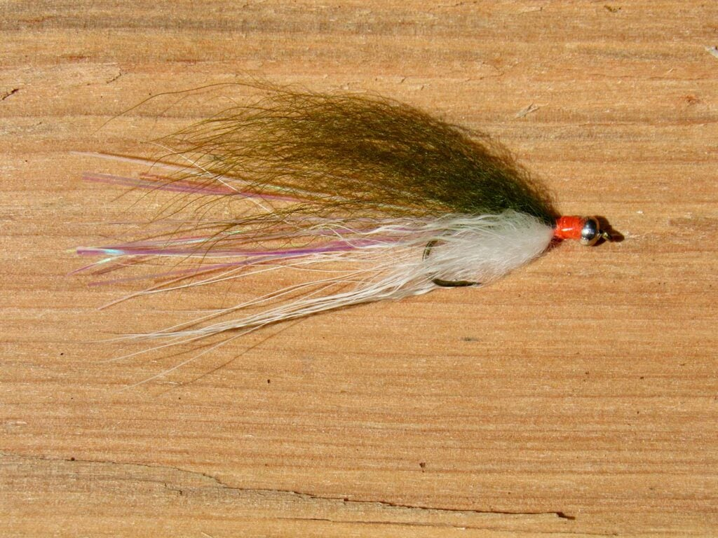 The Little Precious fly lure on a table.