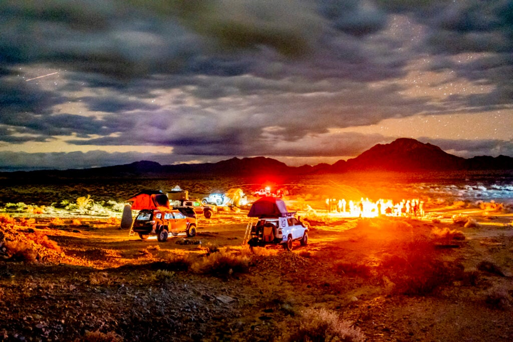 campsite with vehicles at nighttime in the desert.