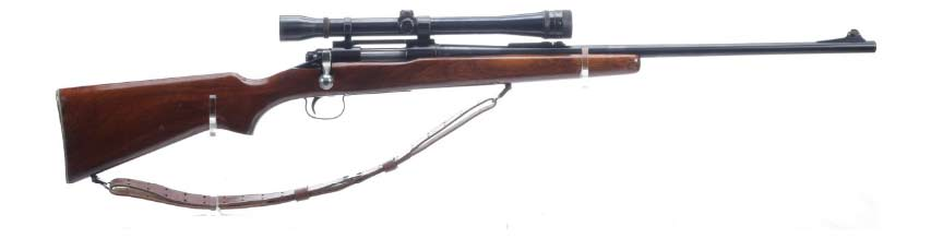 A vintage model 722 rifle on a white background.