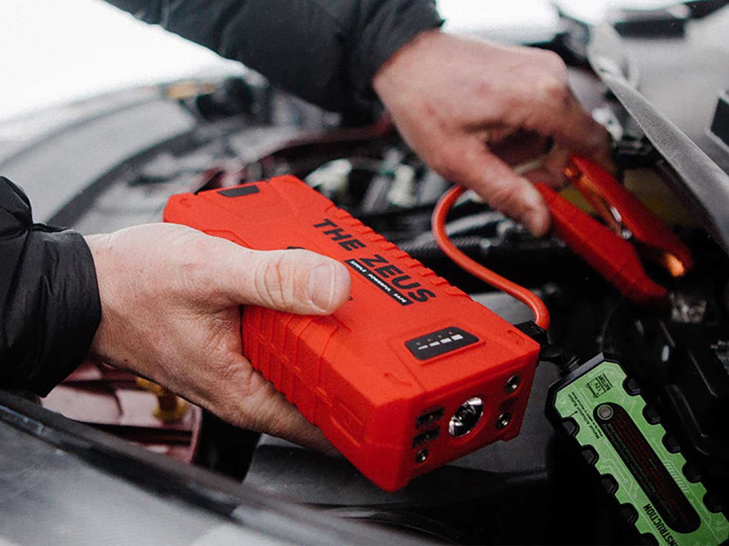 The Zeus Portable Jump Starter hooked to an engine motor.