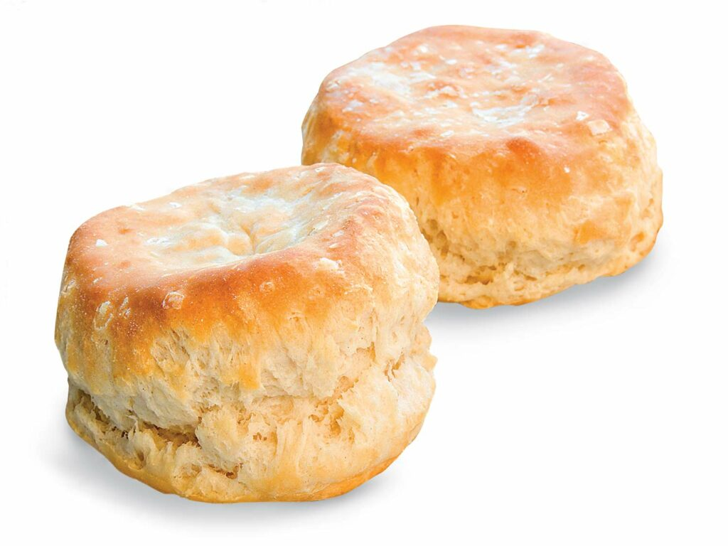 Two butter biscuits on a white background.