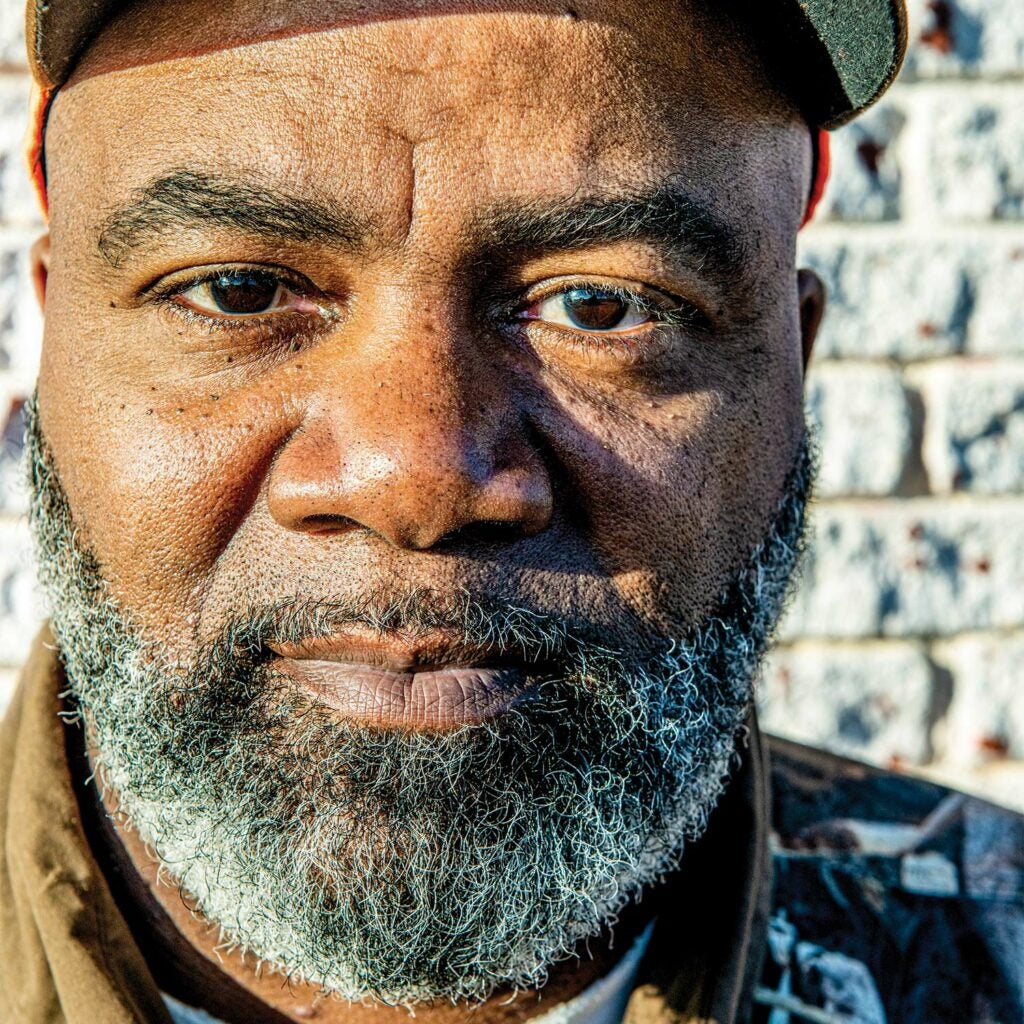 Close up portrait of a black man with a grey and white beard.
