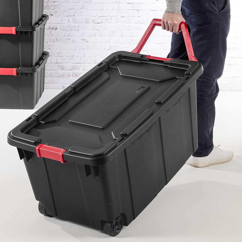 Personal holding a storage bin