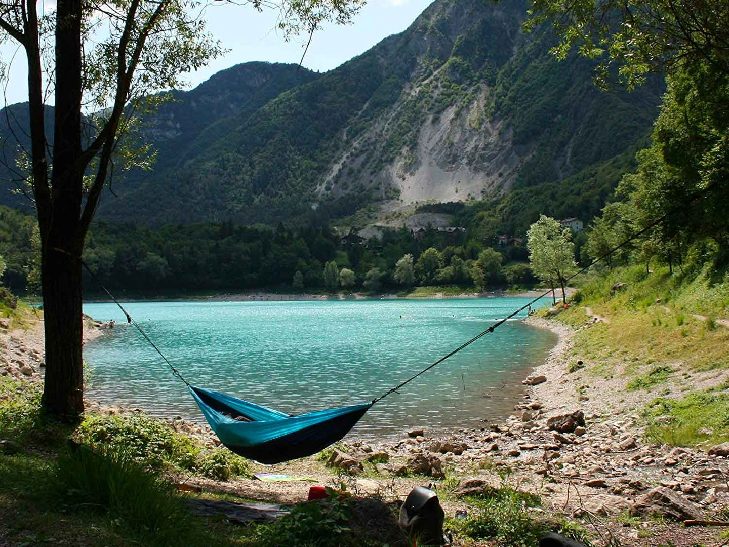 Campsite with hammock by a lake