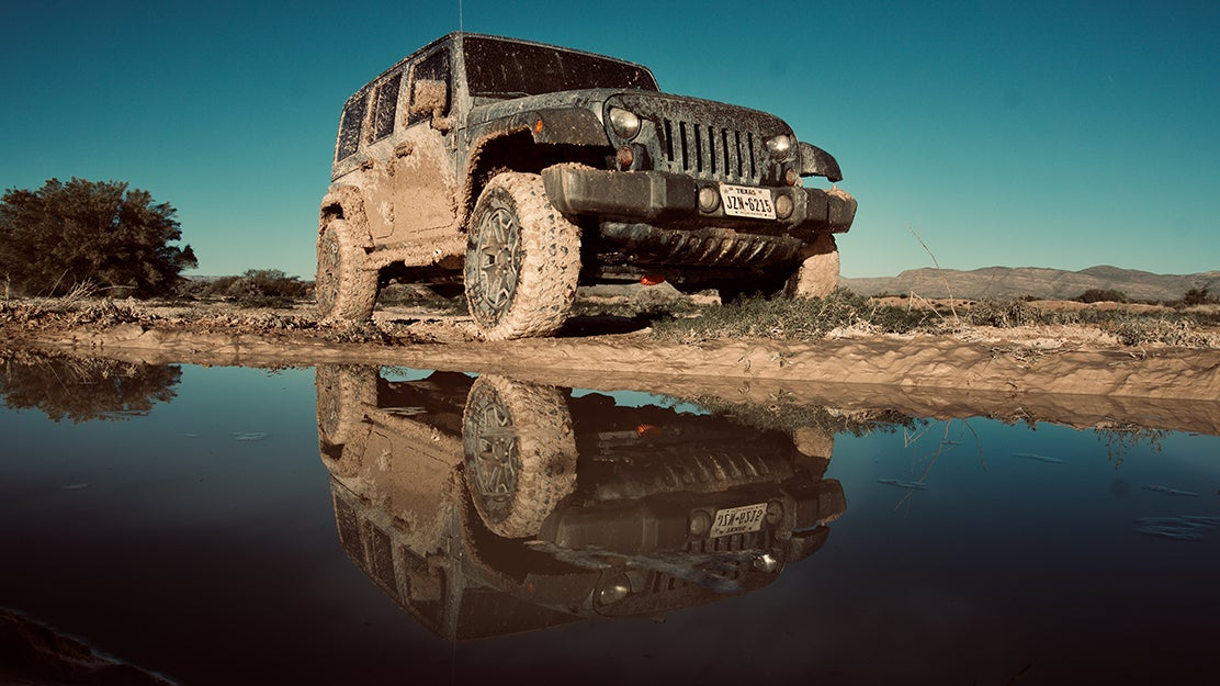 jeep with mud all over it