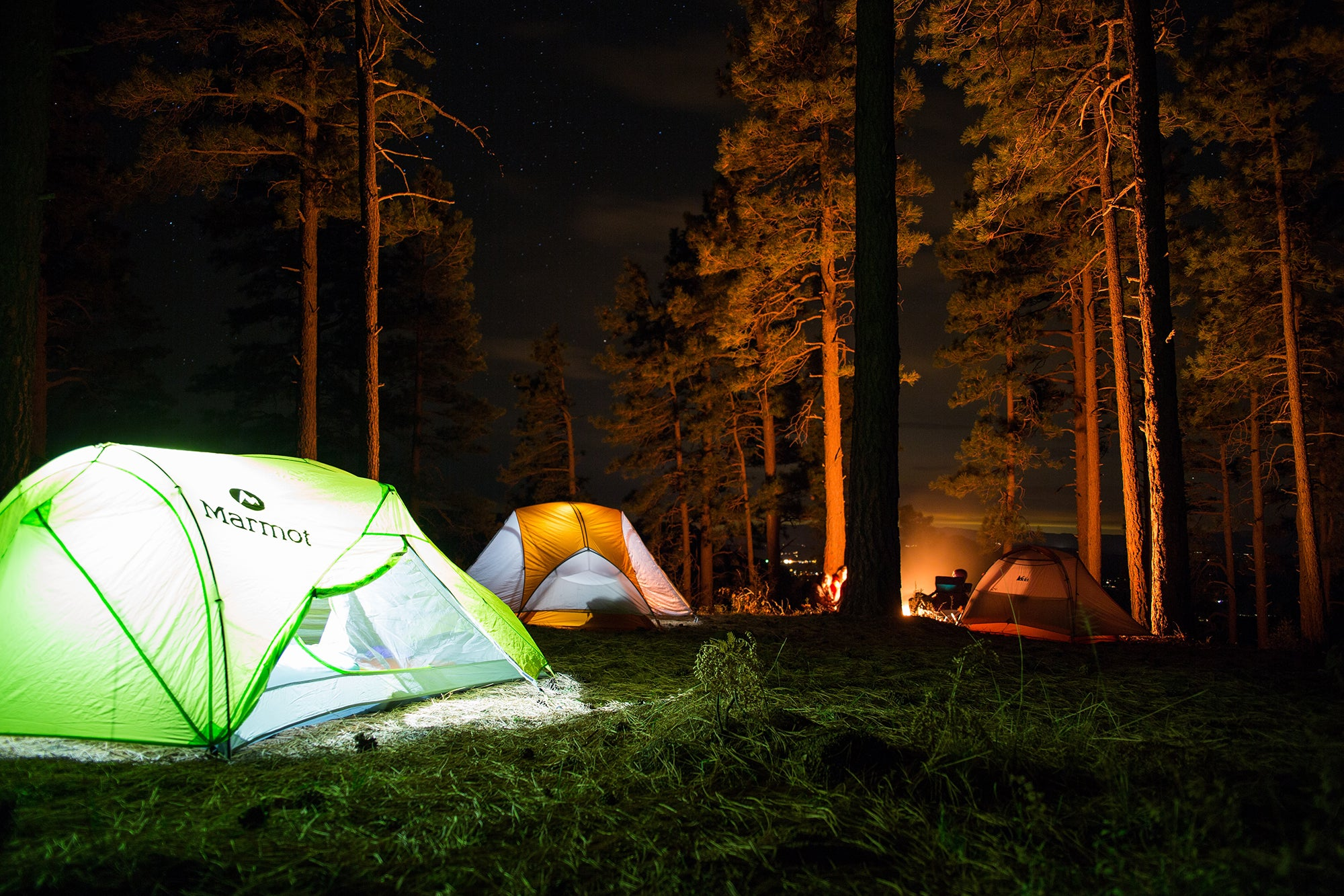 tents at night with lights on
