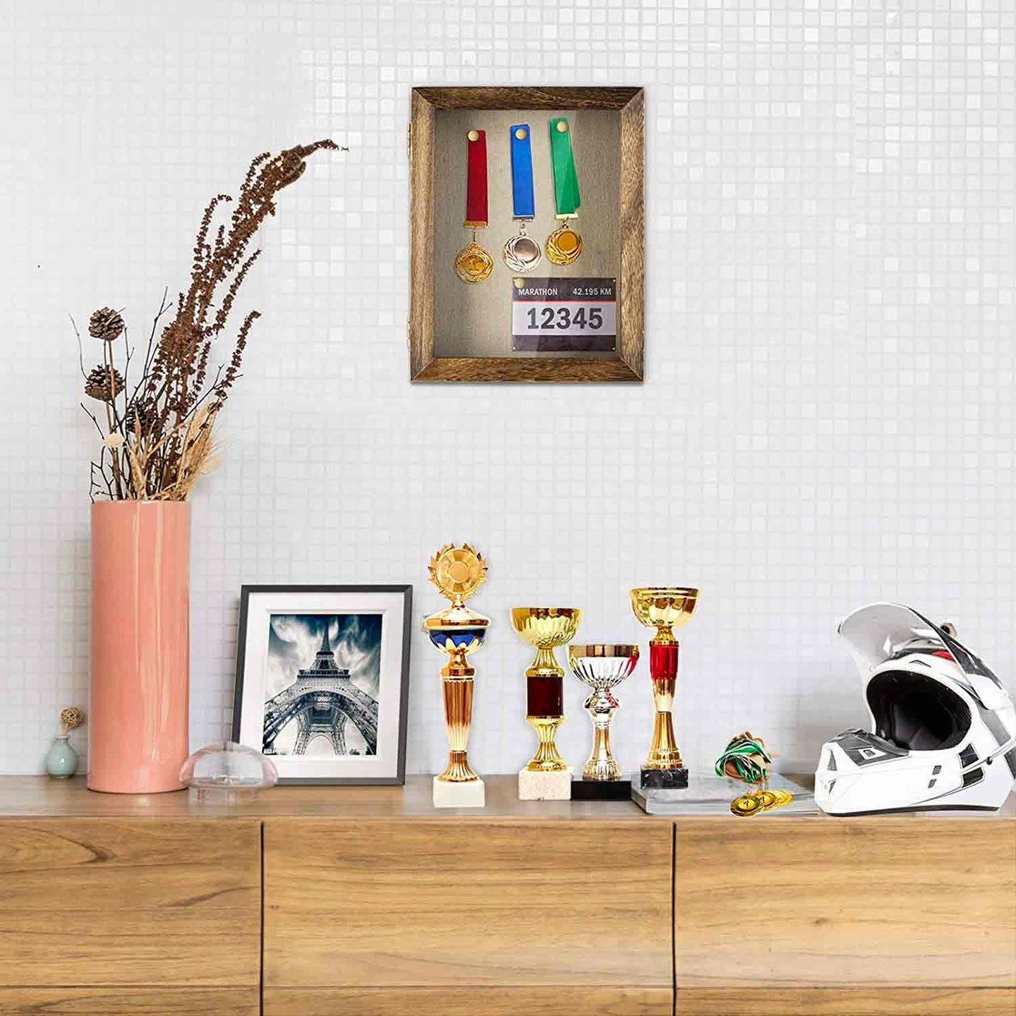 A trophy case hanging on a wall