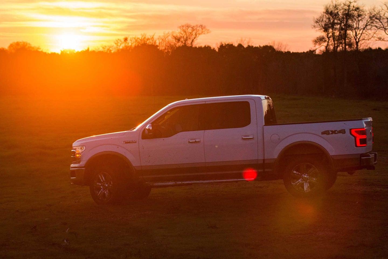 White pickup truck at sunset