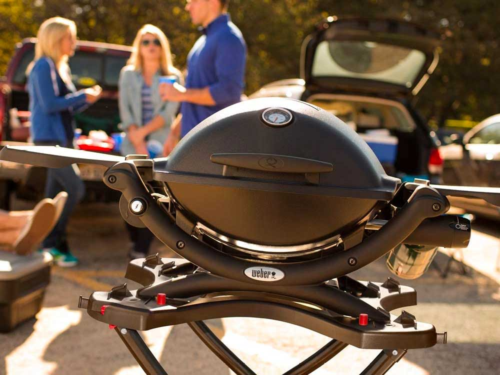 People grilling out in a parking lot