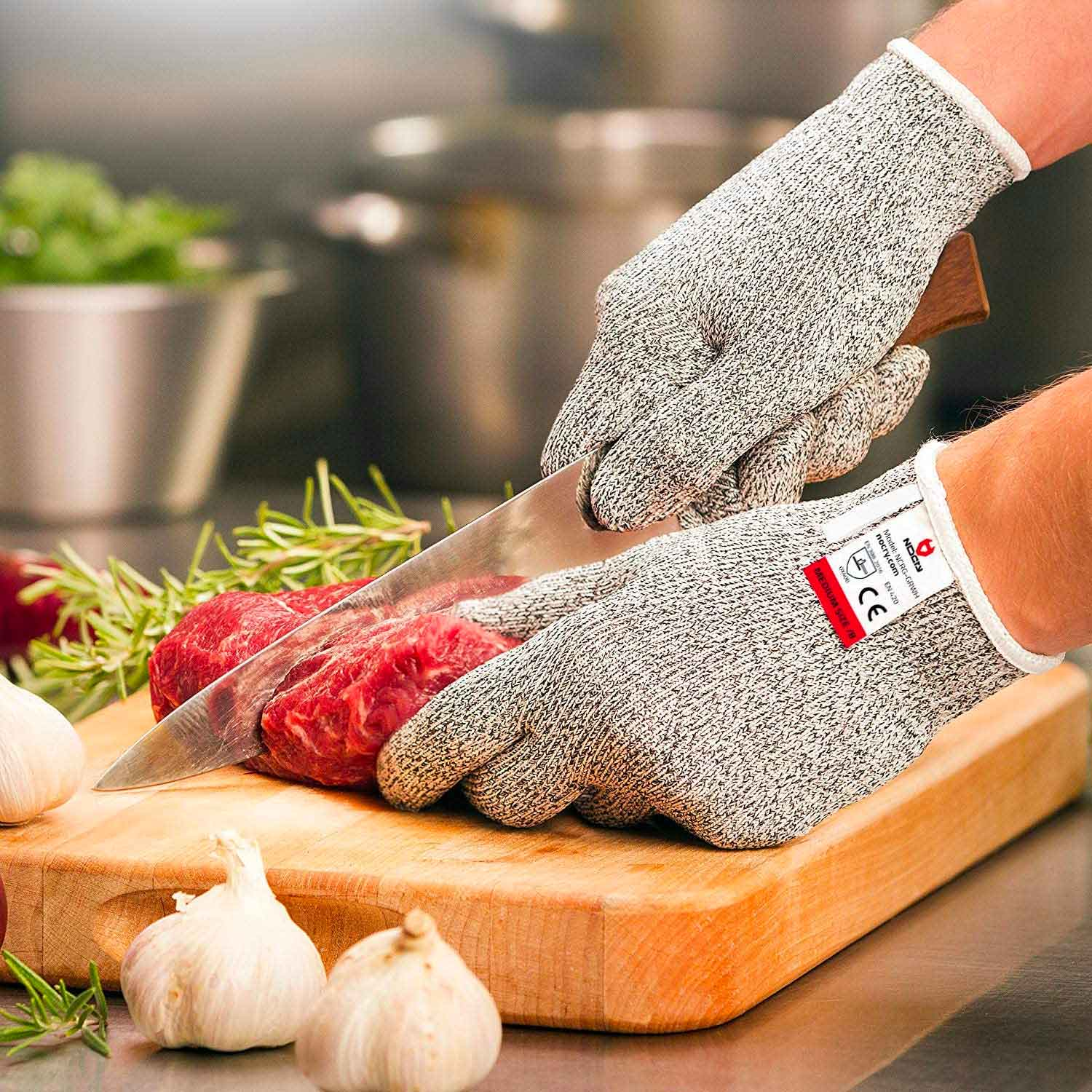 Person using gloves to cut meat