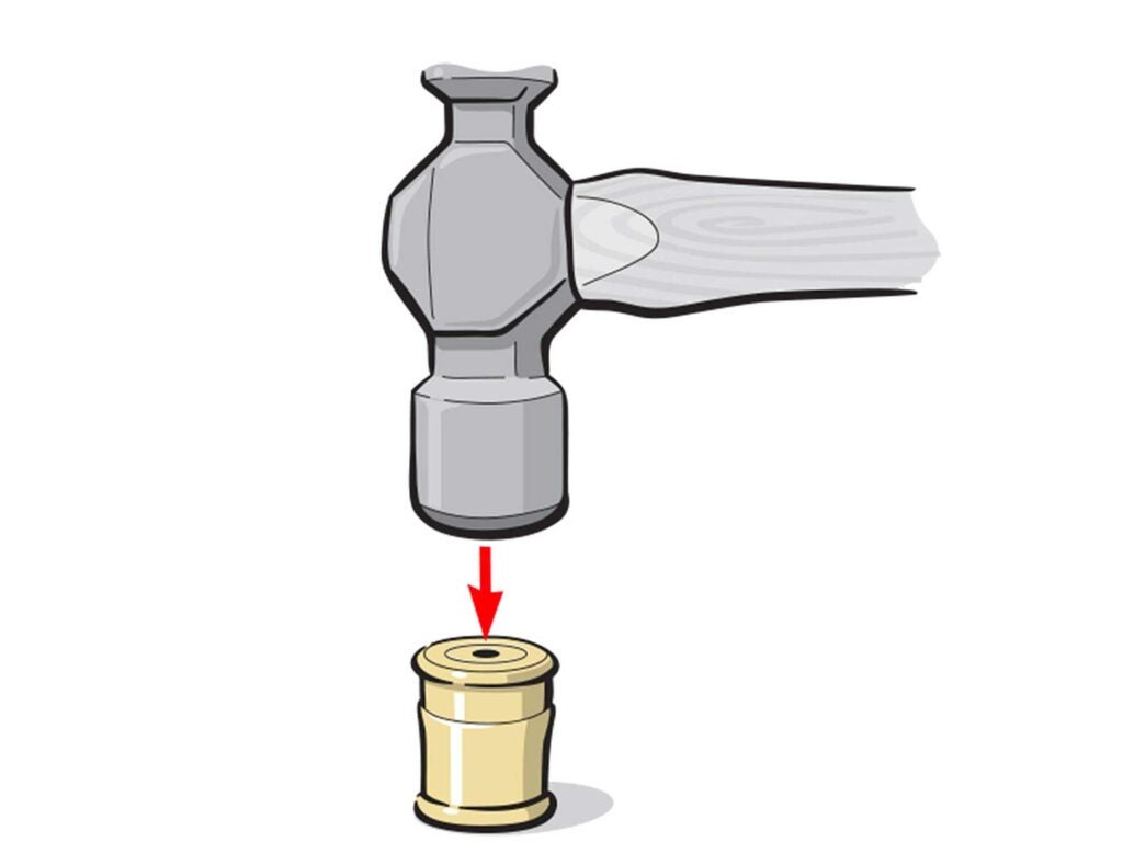 Illustration: Tap the brass head with a hammer to widen the circumference.
