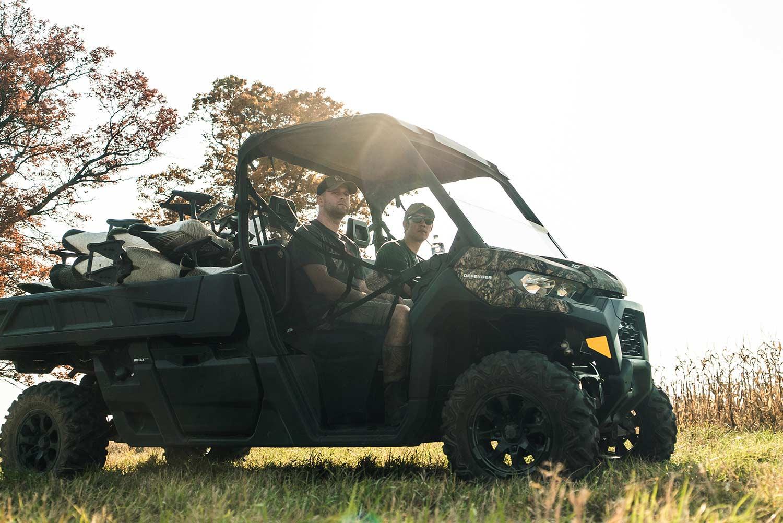 A Can-Am Defender Pro UTV in an open field.