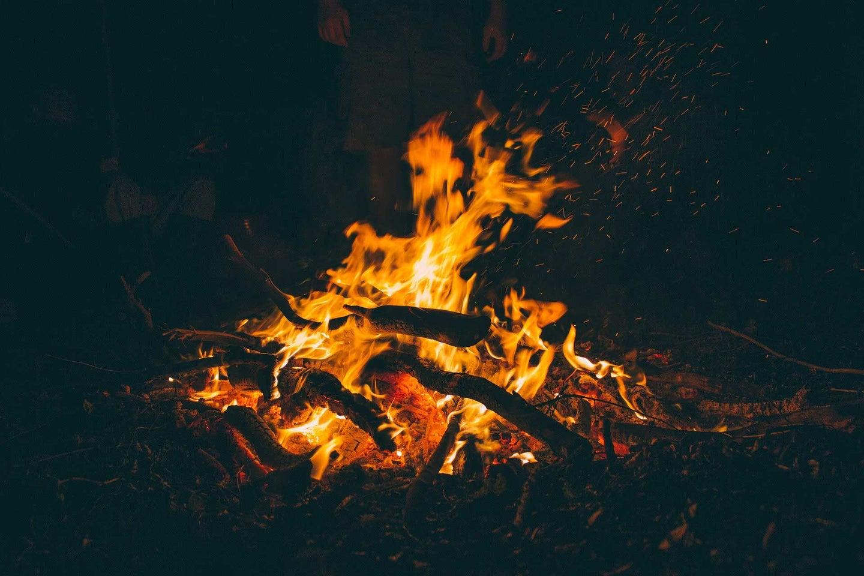 A campfire burning at night.