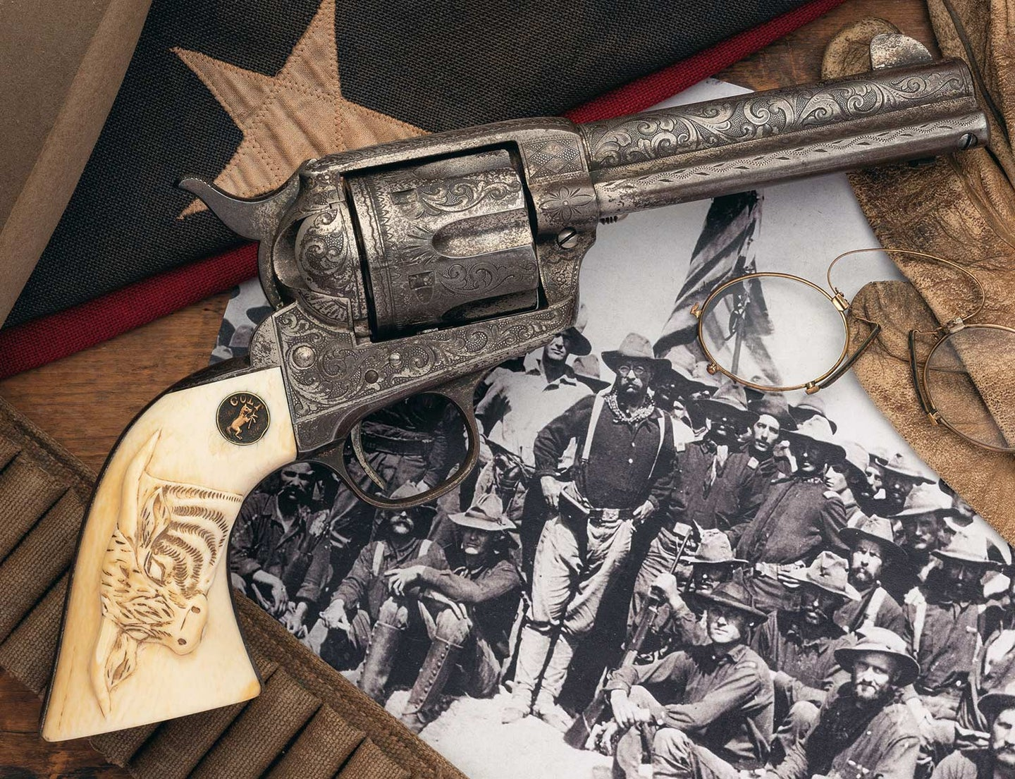 A Colt single action army revolver on an antique photo and flag.