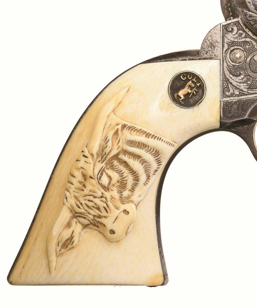 President Roosevelt's Colt revolver handle on a white background.