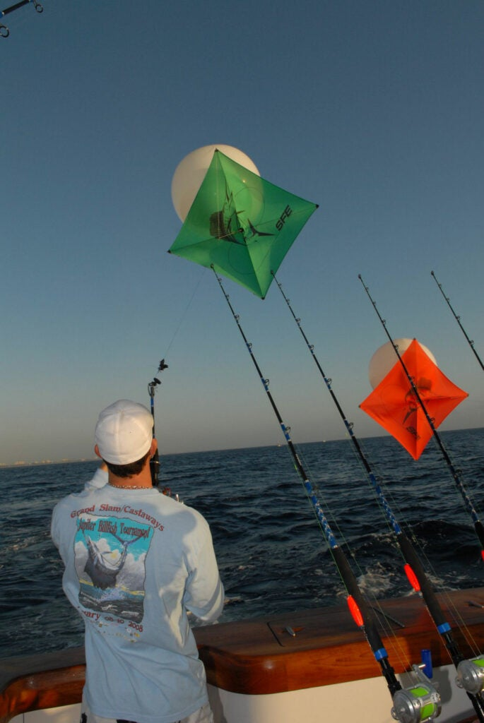 Dangling live baits from kites is a great way to tease a sailfish into chewing.