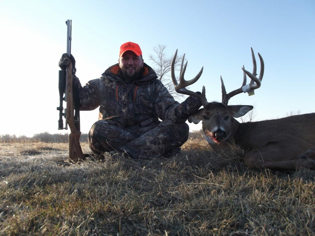 Hunter with a big whitetail buck during the Iowa muzzleloader season.
