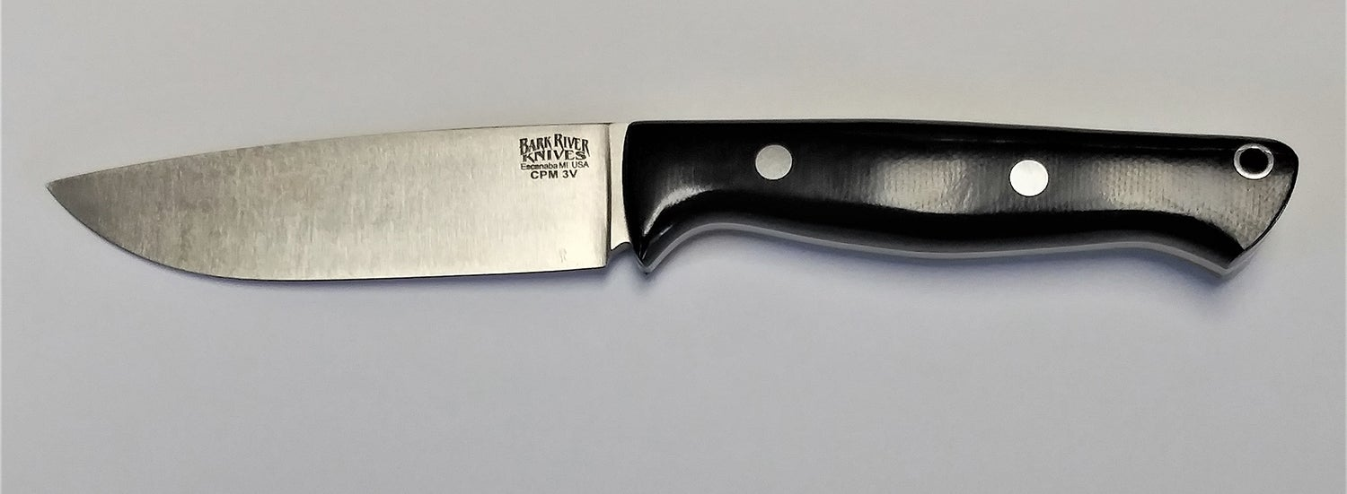 The Bark River Knives Fox River on a gray table.